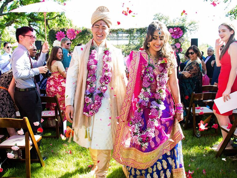 bride and groom at colorful fusion wedding ceremony