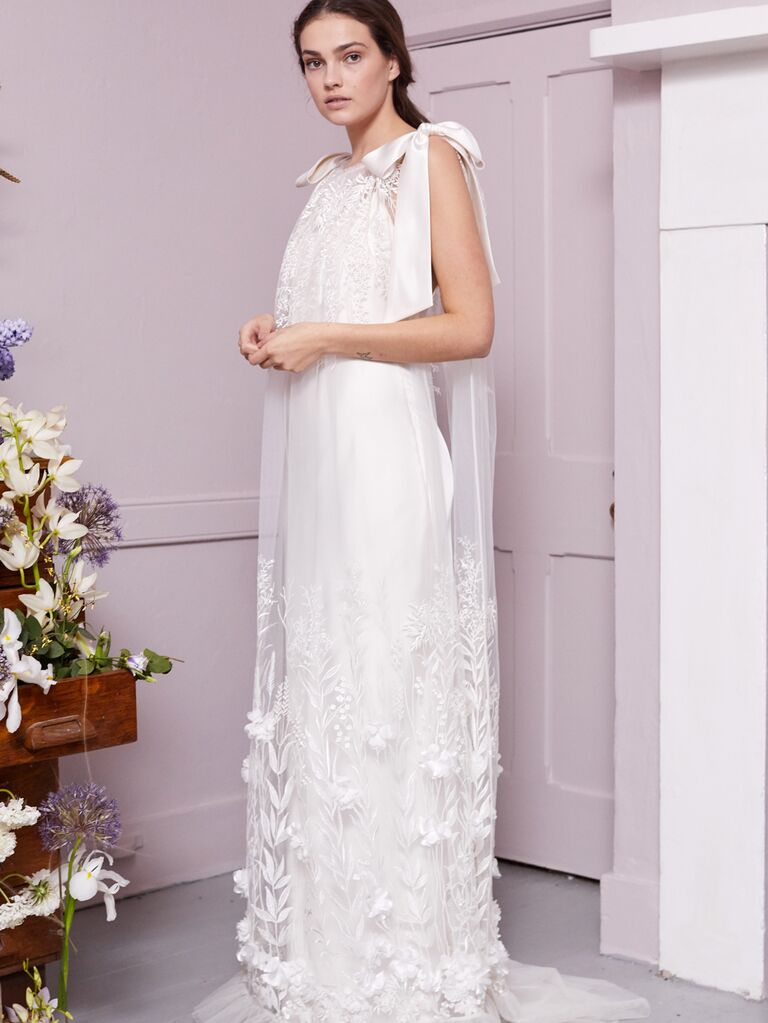 Halfpenny London 2020 Bridal Collection sheath wedding dress with floral appliqué cape