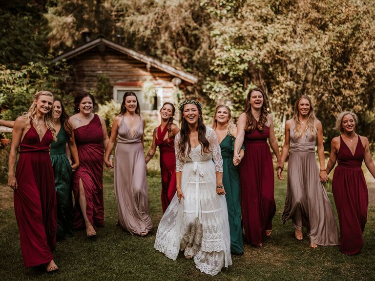 Bride with bridesmaids in emerald, ruby and taupe dresses