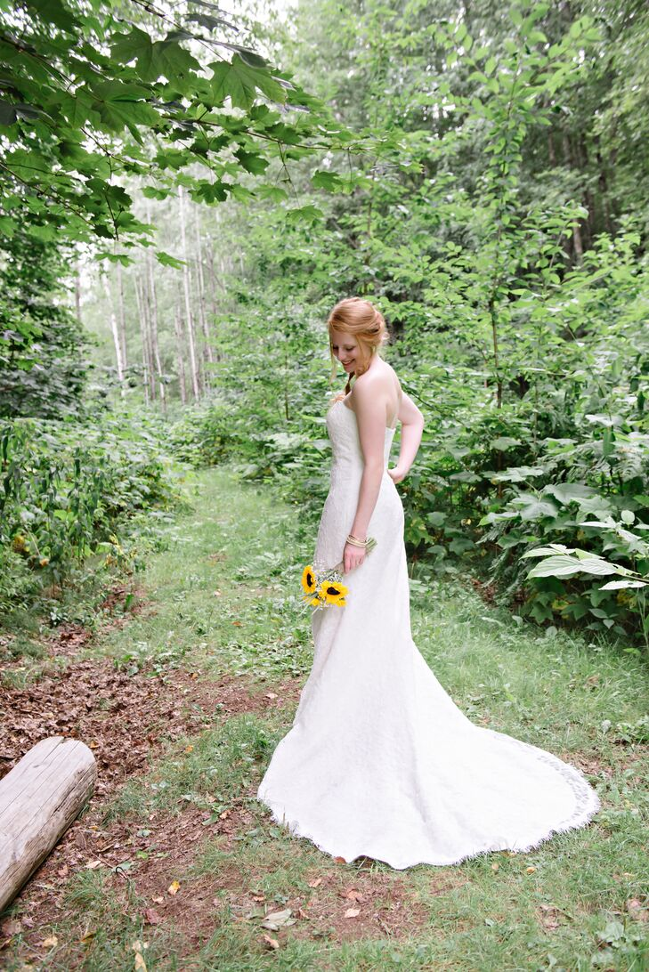 """Emilie got her dress while on exchange in Germany. """"It was actually the very first bridal shop and dress that I tried!"""" says Emilie. """"The dress was a one-of-a-kind Sposa Toscana purchased at Hochzeits Haus in Ludwigsburg, Germany. The gown was a fitted mermaid style and covered in lace."""""""