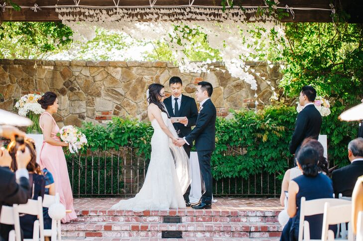 In another DIY feat, Samantha hand-folded origami cones and strung them up to serve as a backdrop during the ceremony. A slight wind during their vows brought mesmerizing movement to Samantha's hard work.