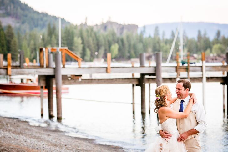 Jennifer and Gregory embraced each other near the water's edge at a private residence in Tahoma, California. Gregory wore a light tan vest with matching pants, along with a white collared shirt and a royal blue tie. Jennifer wore a strapless wedding dress with a sweetheart neckline and a ball gown skirt.