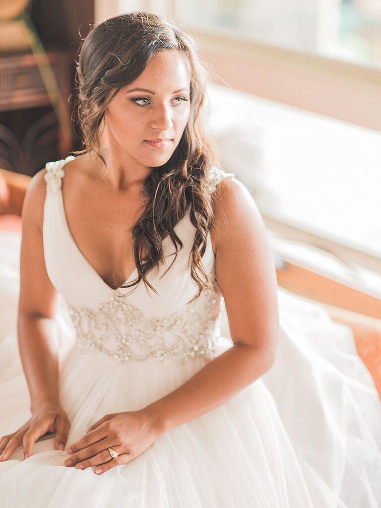 Curled sideswept wedding hairstyle