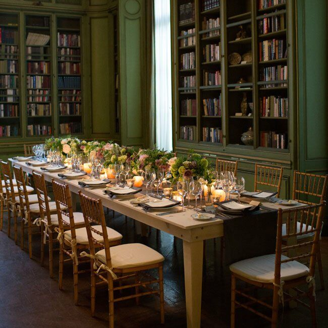 The couple selected a variety of low arrangements for their centerpieces to ensure that guests had an easy time interacting around the long rectangular tables.