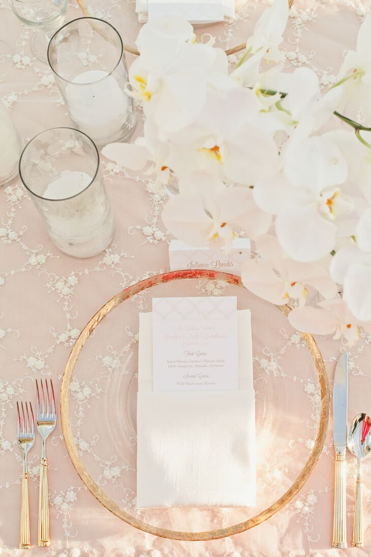 Gilded-edged chargers and two-toned cutlery brought a dash of glamour and sophistication to the tables' textured blush linens, while complementing the twinkling chandeliers and gold chiavari chairs.