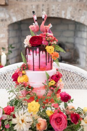 Pink Wedding Cake with Flowers and Flamingo Topper