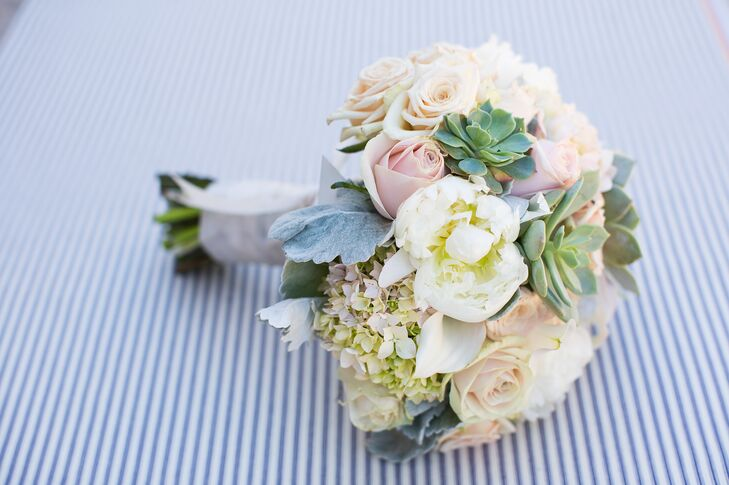 Brooke held a round bouquet filled with pastel-colored peonies, roses and hydrangeas, plus a green succulent or two. Similar arrangements decorated the day, from the altar arrangements to the dining table centerpieces.