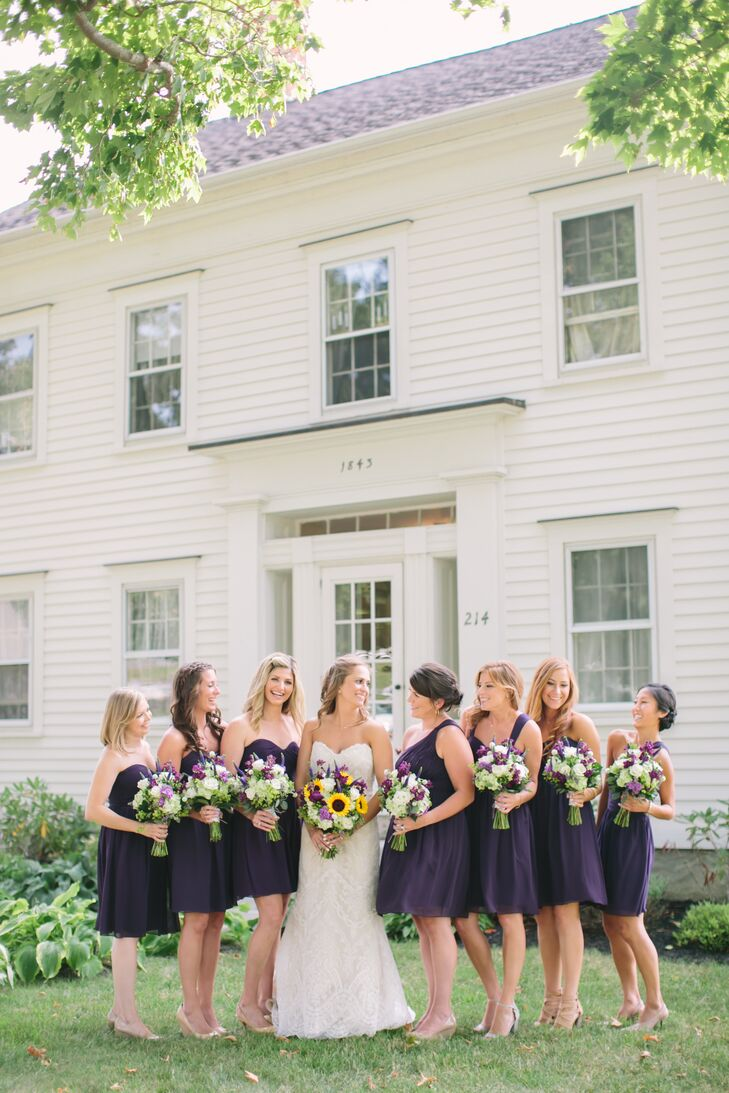 Striking shades of purple popped up throughout the day, adding vibrancy and dimension to everything from the rustic floral arrangements dotting the reception tables to the bridesmaids' Donna Morgan cocktail dresses. Airy purple chiffon and knee-length A-line silhouettes helped create a feeling of cohesion, while mix-and-match necklines let each woman showcase her own personality.