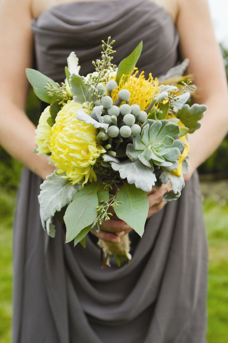 The bridesmaids carried bunches of football mums, tansy, yarrow, white lisianthus, dusty miller, seeded eucalyptus, silver brunia and yellow pincushion proteas.