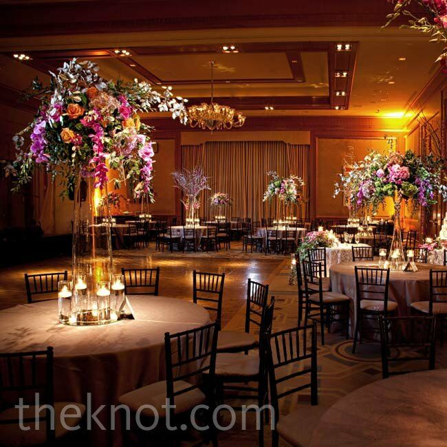 Tall centerpieces of silver branches and orchid leis added height and drama to the spacious ballroom.