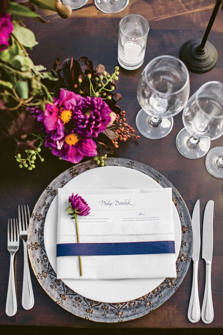 The menu cards were tucked into ivory napkins topped with single dahlia blooms and wrapped with a blue French ribbon.