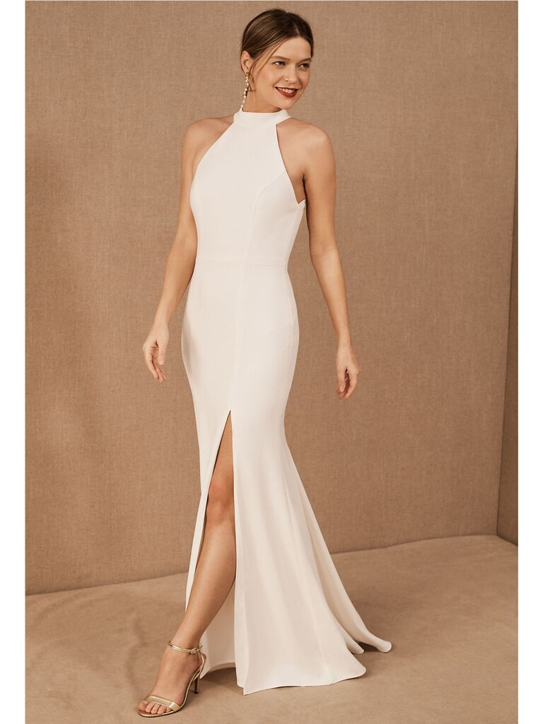 Fitted high-neck wedding dress with slit