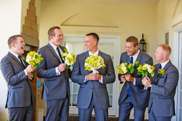 Groomsmen Holding Bridal and Bridesmaid Bouquets