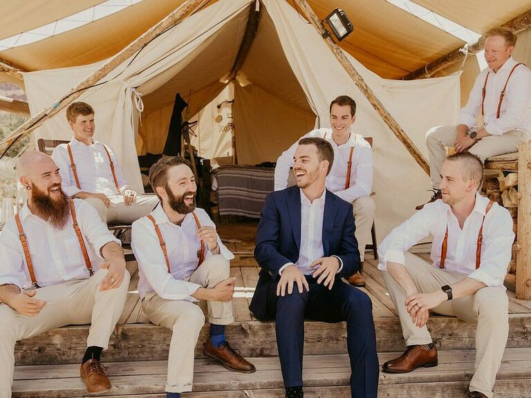 Groom chatting with groomsmen before wedding ceremony