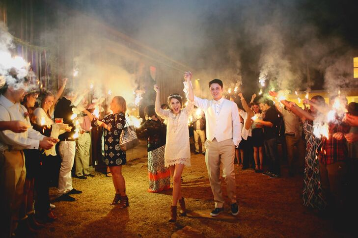 At the end of the night, after the last song had been played, Madelyn and Ryan's family and friends gathered outside to send them off through a tunnel of brightly lit sparklers—the perfect end to a laid-back bohemian fete.