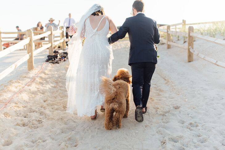 Couple Recessing with Pet Dog at Beach Ceremony