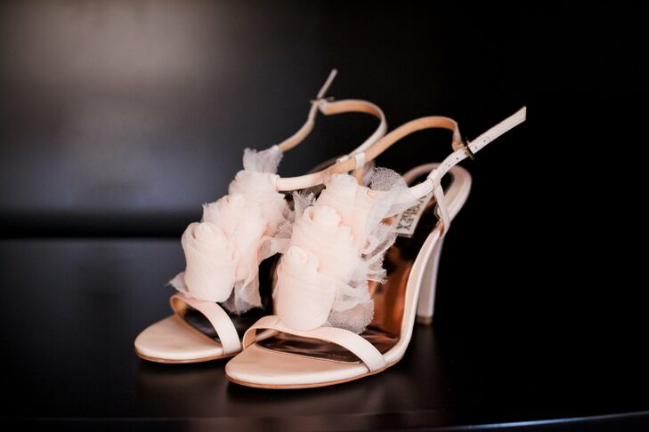 Blush pink heels with tulle rosebuds on the front added to the vintage, ethereal bridal style.