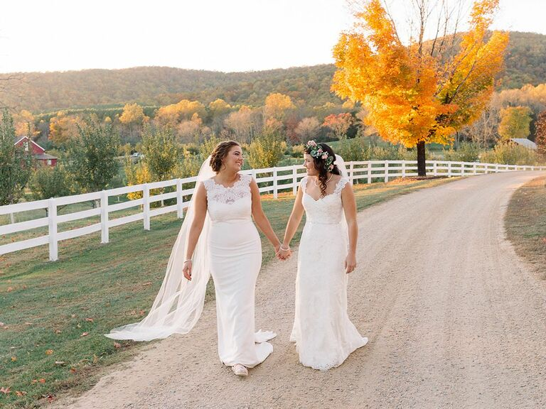 bride and bride holding hands outside in Virginia