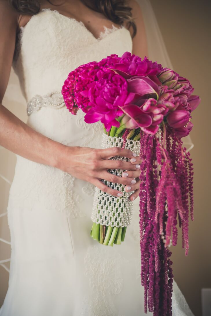 Emily wrapped her stunning fuchsia cascade bouquet with an equally gorgeous statement wrap.