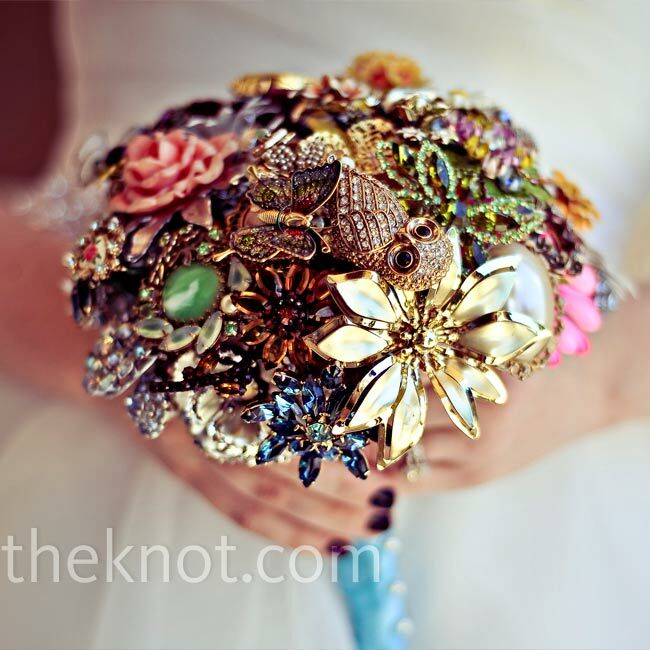 Heather's bouquet was made from Michael's first watch, brooches from five generations of his family and an owl ring.