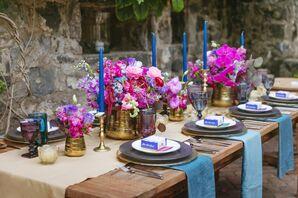 Dining Table with Pink Flowers and Blue Candles