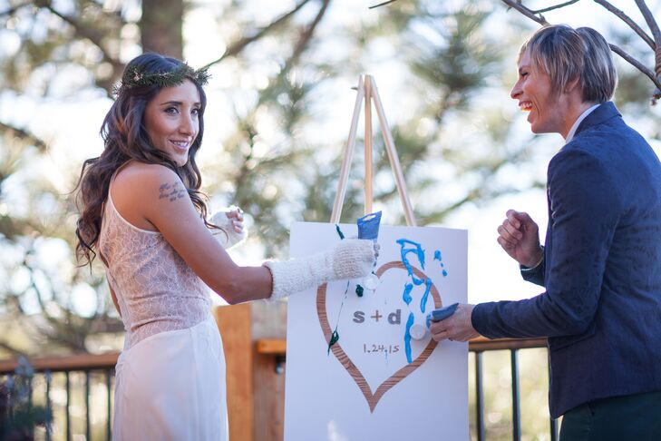 As part of the outdoor ceremony, Debora and Sara painted over a white canvas with a brown heart around their first initials and date.