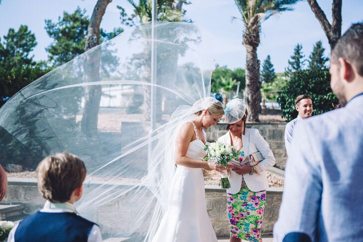 Bride's 1920s Veil Blowing in Wind After Ceremony