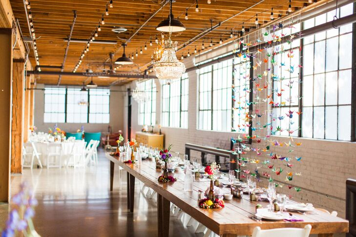 Industrial Loft with Colorful Hanging Paper Decorations