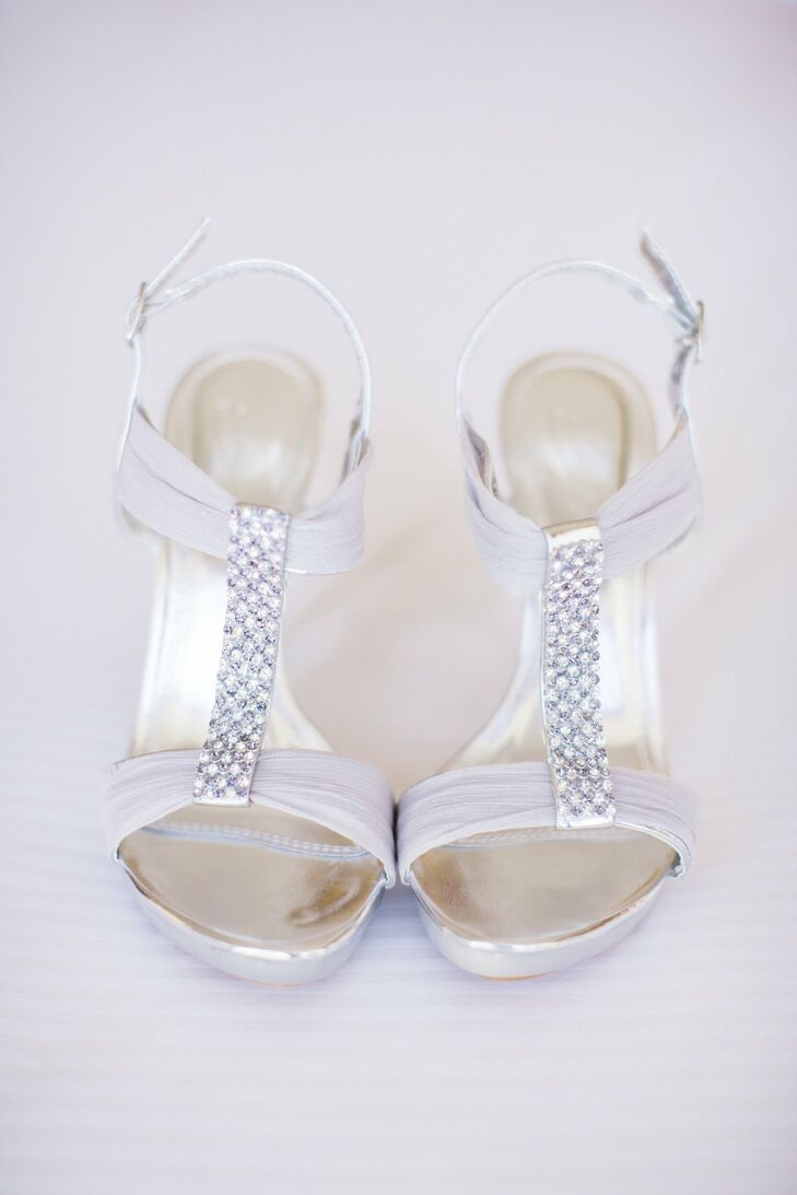 The bride wore these silver T-strap sandals down the aisle during her ceremony.