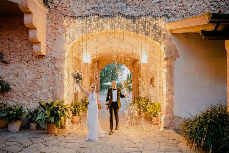 Couple Enters Mallorca Wedding Reception Through Curtain of String Lights