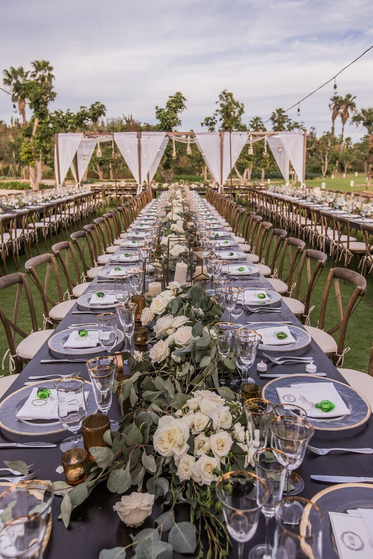 """It was important to play on the farm's natural charm, so we decided to go with neutral tones accented in emerald green and added in some gold glitz with sequin linens and lanterns,"" Katie says. ""Our vision for the evening was to host one big glamorous dinner party."""