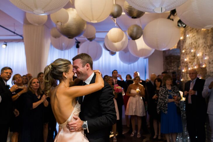 The newlyweds shared a sweet first dance under an array of paper lanterns at the Upper Crust—an intimate restaurant in New York City's West Village neighborhood.