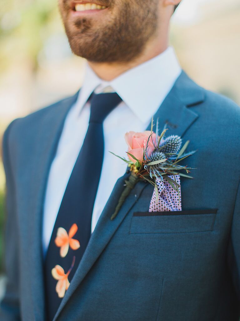Matching tie and boutonniere groom's look