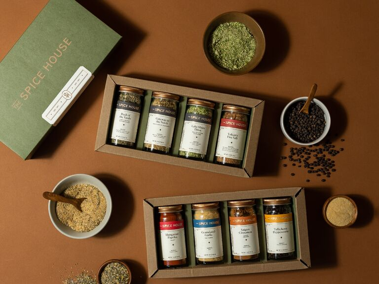 Deluxe box set of eight spices shown with various spices in bowls on the table
