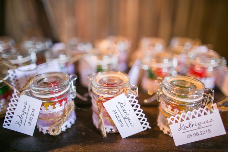 Kristen used to babysit, so children are a huge part of her life. Their wedding favors brought out the kid in every guest with these mini glass jars filled with candy.