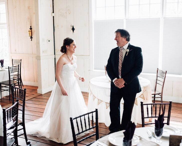 Heather wore a strapless, A-line wedding dress in champagne with a sweetheart neckline. The gown featured lace details in the bodice. The satin skirt had a tulle overlay, creating a romantic and flowing silhouette.