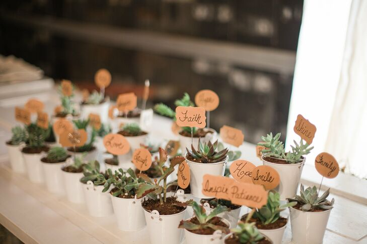 "Guests took home succulent plants with cute labels like love, hope and faith. ""Every element was special and reflective of out love for our family and friends,"" Nikki says."