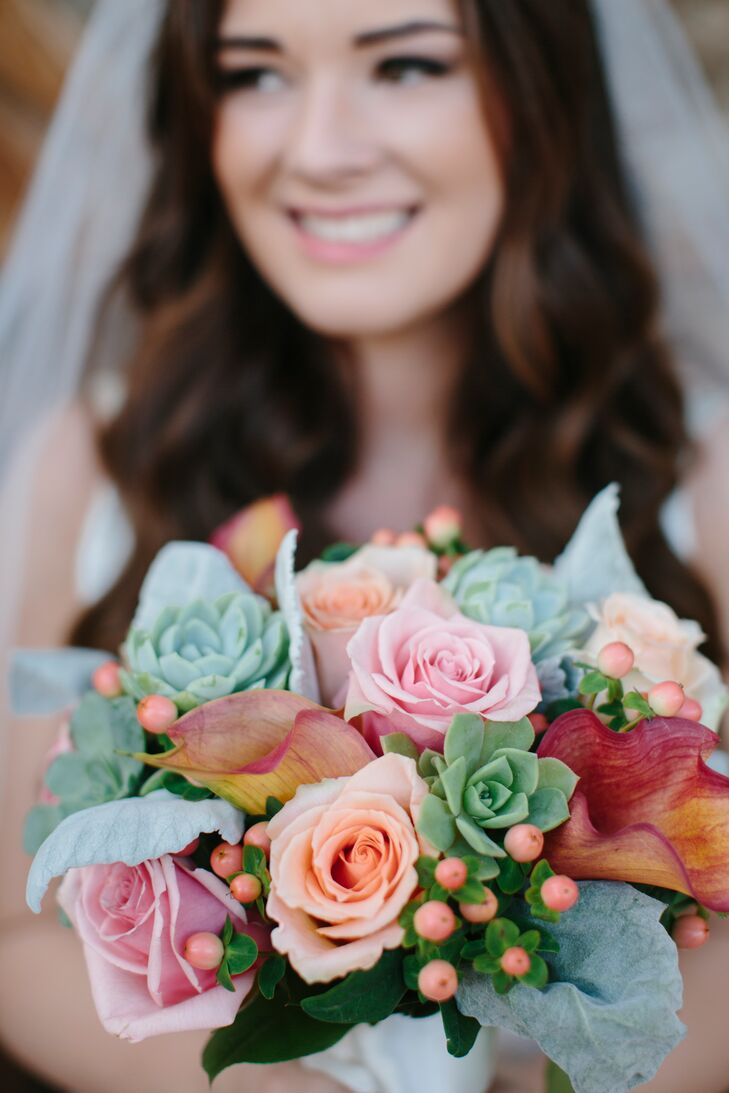 "Based on what Katie told the Garden District, the florist created a beautiful pink and orange bouquet filled with roses and succulents, not to mention a red calla lily or two added into the mix. ""My grandmother unexpectedly passed away seven months before the wedding,"" Katie says. ""I wrapped a gold coin necklace of hers around the base of the bouquet for a little sentimental value of having her with me."""