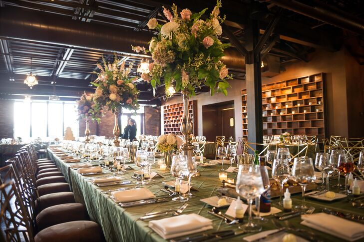 Jillian and Evan hosted their reception at Canal 337, a modern, loft-style venue with views of downtown Indianapolis, Indiana. The space was set up with sage green dining tables for the reception.