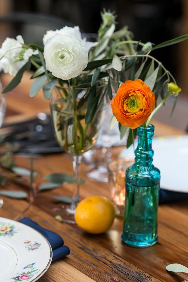 """Marla and Trevin included citrus in their centerpieces """"for a fun edge,"""" the bride says."""