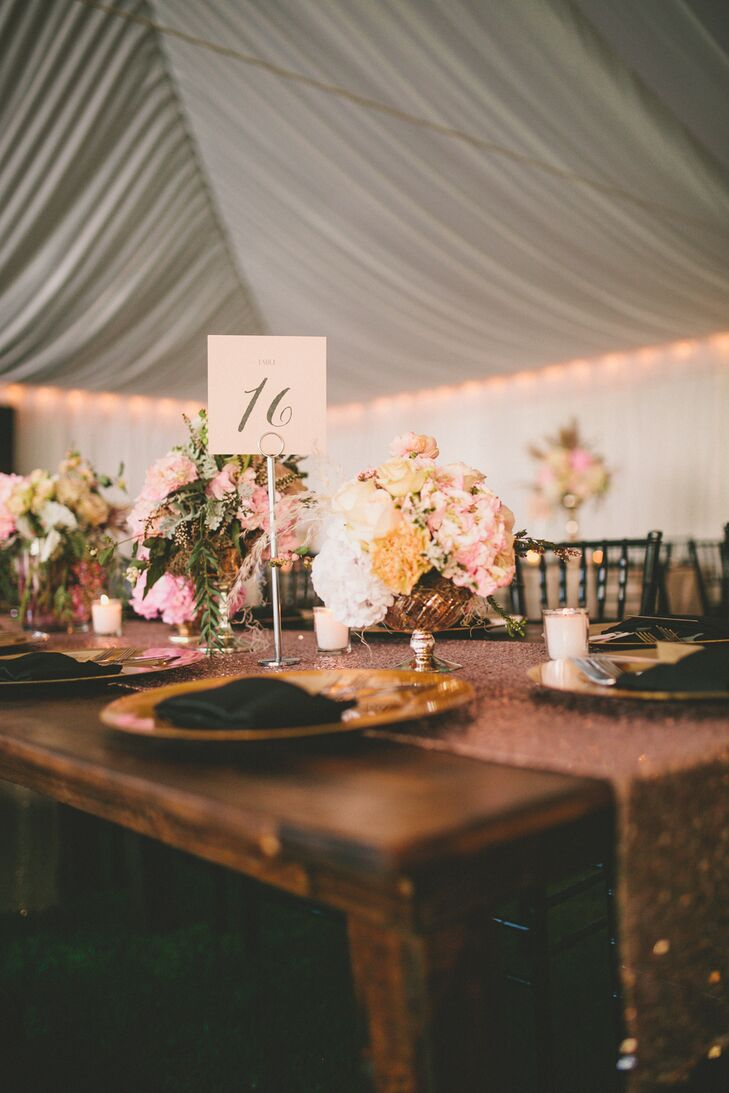 """To achieve the soft and romantic vibe I desired, I worked with my wedding planner to let blush pink shine as our main color and accented it with touches of ivory, gold and even black. We opted for a large draped tent and included wooden farm tables and sequin linens to help combine the aesthetics."""