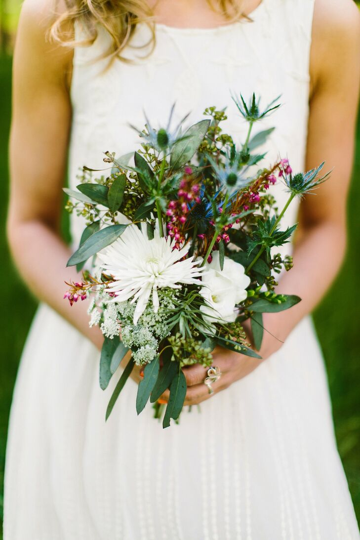The bridesmaids bouquets were a mix of eucalyptus, airplants, thistles, mums, Queen Ann's lace, fressia and heather.