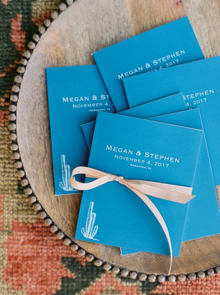 Blue wedding programs with cactus illustrations