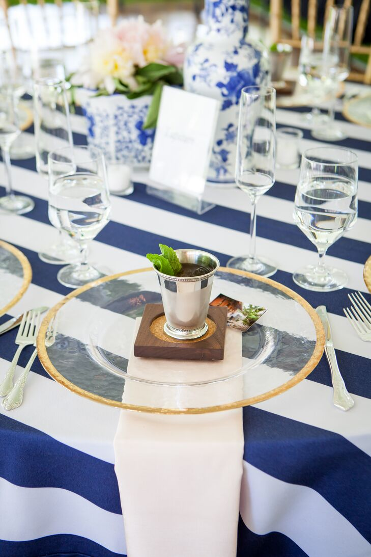 """I really wanted to add a lot of visual interest and texture by adding the chunky blue and white striped tablecloths to really kick it up a notch,"" says Kate. Blush peonies and accent linens softened the look while gold accents added a hint of sparkle."