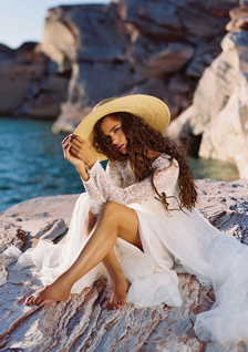 casual bride in long sleeved wedding dress and straw hat