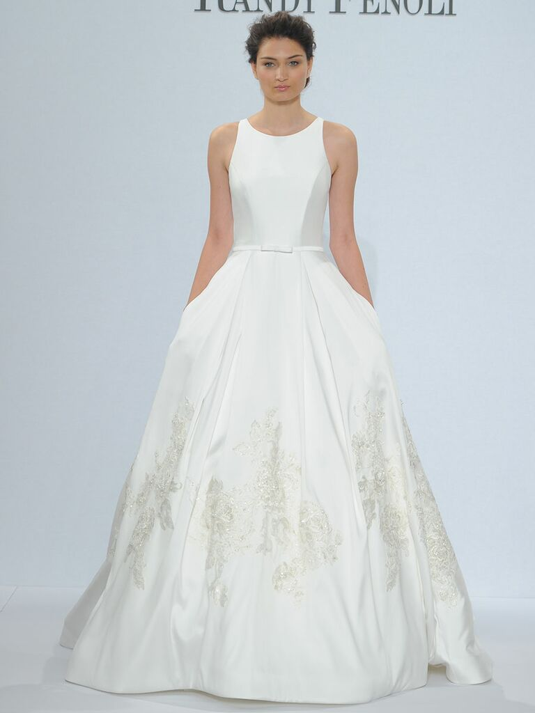 Randy Fenoli Spring 2018 sleeveless Mikado ball gown with modified Sabrina neckline, natural waist box pleated skirt, pockets and beaded floral appliqués