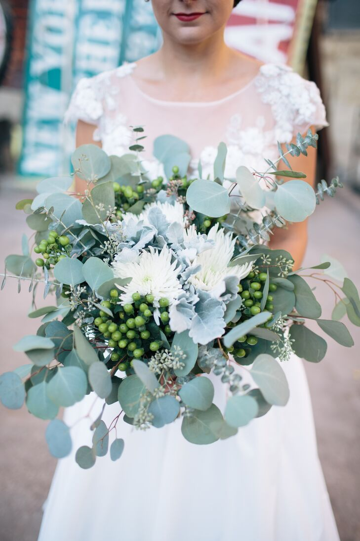 """""""Our florist, A Pretty Flower, completely understood my vision and helped me create these lush, green, fragrant bouquet full of eucalyptus, mums and lamb's ear,"""" the bride says."""