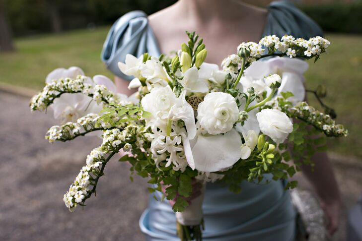 The bridesmaid bouquet was a loose gathering of garden roses, freesias and lady slipper orchids, all in shades of white and green.
