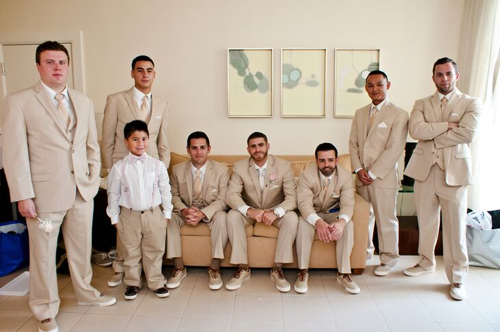 Ethan and his groomsmen wore khaki suits with matching sneakers and neutral ties. Ethan stuck out with a white top atop his classic white shirt.