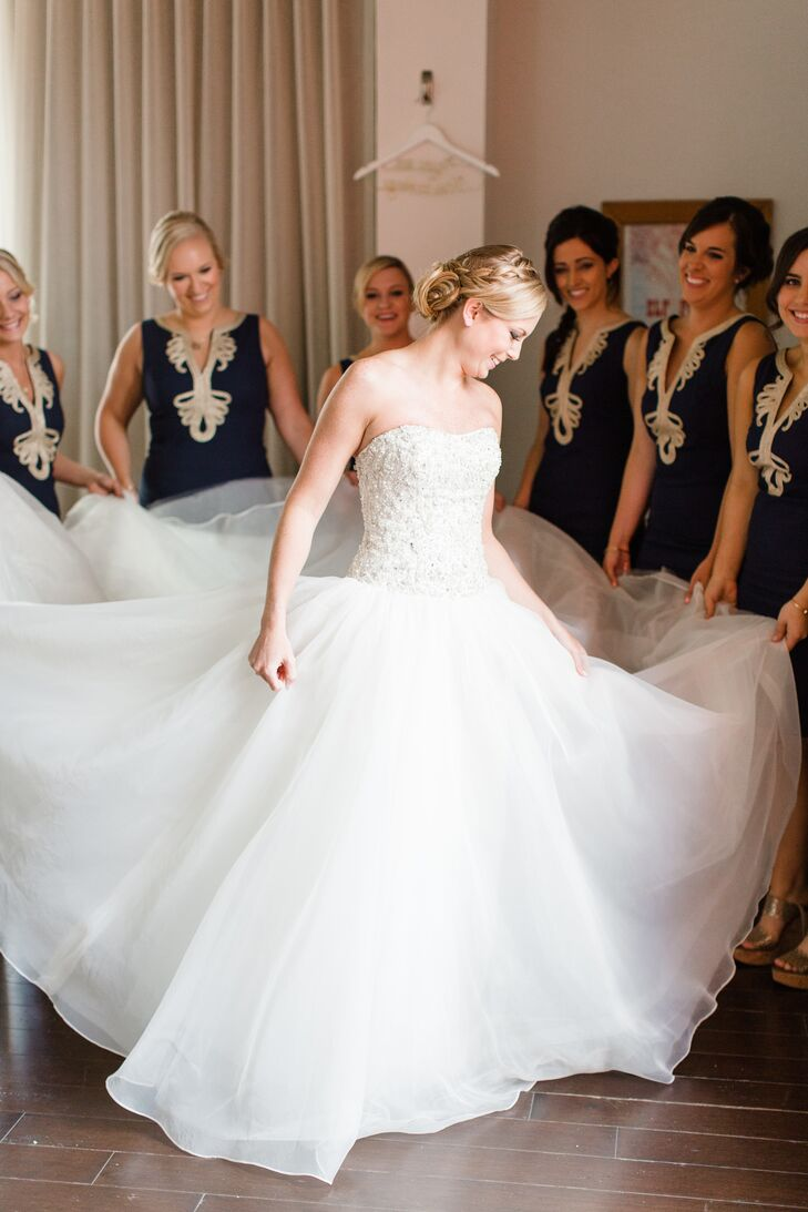 "Carrie's Bridal Collection was Kelsey's only stop to find her dress. She wore a one-of-a-kind ball gown with a strapless beaded bodice and full organza skirt. ""When I put on my dress, I knew that was it,"" Kelsey says."